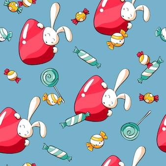 Het naadloze patroon van pasen met konijntjes, snoepjes en eieren