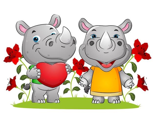 Het paar gelukkige neushoorns die liefde uitdrukken op de valentijnsdagillustratie