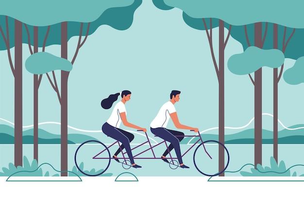 Het paar rijdt op de fiets op de achtergrond van het natuurlijke landschap