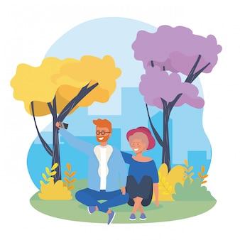Het paar van de jongen en van het meisje met bomen en struikeninstallaties