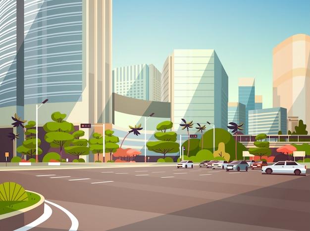 Het parkeren van de stadsauto over moderne cityscape van wolkenkrabbergebouwen
