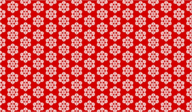 Het patroon met sneeuwvlokken op een rode achtergrond
