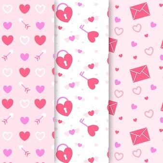 Het patroon van de valentijnskaartendag in vlak ontwerp wordt geplaatst dat