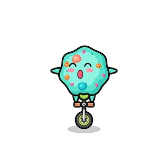 Het schattige amoebe-personage rijdt op een circusfiets, schattig stijlontwerp voor t-shirt, sticker, logo-element