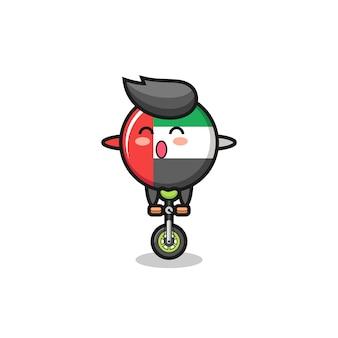 Het schattige karakter van de vlag van de vae rijdt op een circusfiets, schattig stijlontwerp voor t-shirt, sticker, logo-element