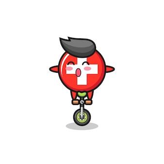 Het schattige karakter van de vlag van zwitserland rijdt op een circusfiets, schattig stijlontwerp voor t-shirt, sticker, logo-element