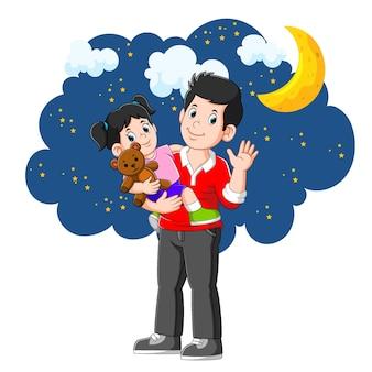 Het schattige meisje gaat in een prachtige nacht met zijn vader naar bed