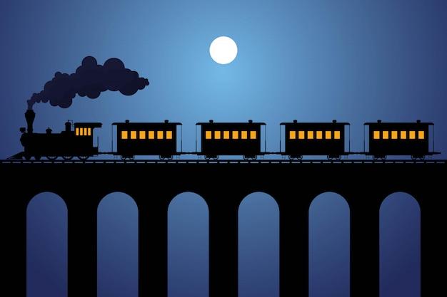 Het silhouet van de stoomtrein met wagons op de brug in de nacht