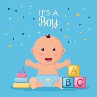 Het speelgoed van de babydoucheviering is een gelukkige jongen