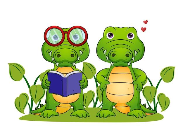 Het stel van de slimme krokodil houdt het boek vast en staat in de illustratietuin