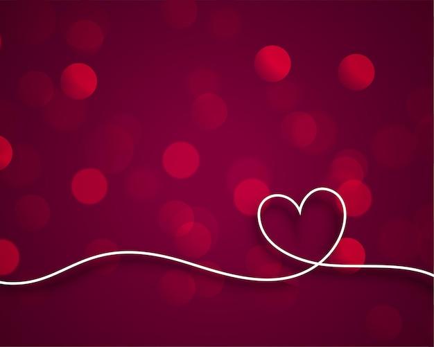 Het stijlvolle hart van lijnvalentijnskaarten op bokehachtergrond