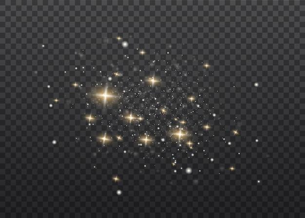 Het stof is geel. gele vonken en gouden sterren schijnen met speciaal licht. schittert op een transparante achtergrond. kerst lichteffect. sprankelende magische stofdeeltjes.
