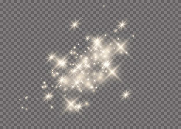 Het stof is geel. gele vonken en gouden sterren schijnen met speciaal licht. vector schittert op een transparante achtergrond. kerst lichteffect. sprankelende magische stofdeeltjes.