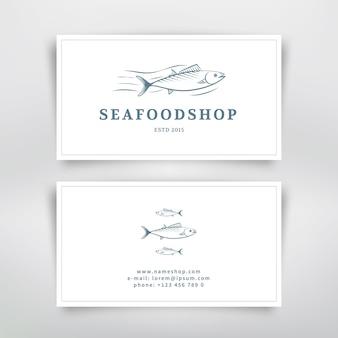 Het visitekaartjeontwerp van zeevruchten met vissen. vector sjabloon