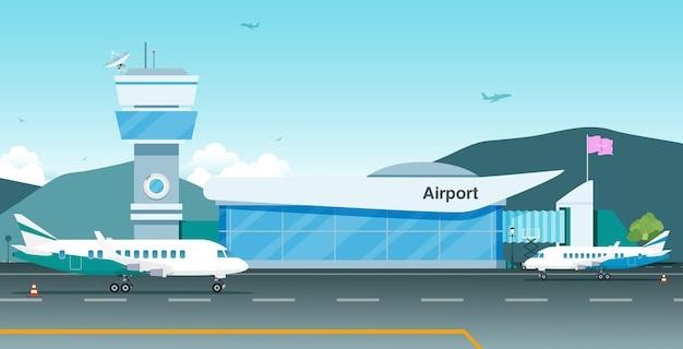 Het vliegtuig staat geparkeerd op de luchthaven met bergen op de achtergrond