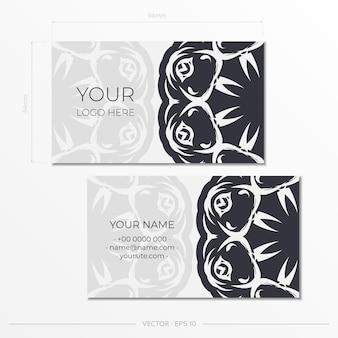 Het voorbereiden van witte visitekaartjes met vintage patronen. sjabloon voor afdrukontwerp visitekaartje met monogram ornament.
