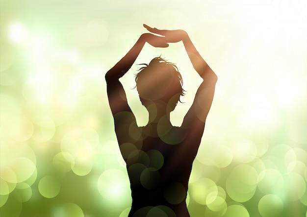 Het wijfje in yoga stelt tegen de achtergrond van bokehlichten