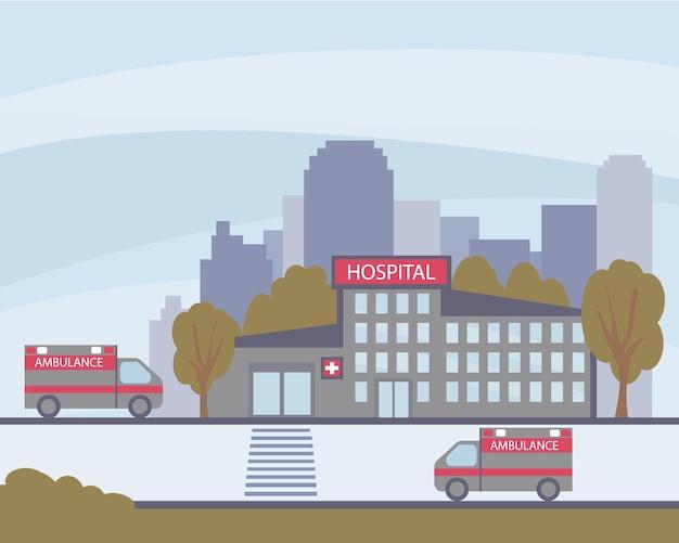 Het ziekenhuisgebouw van buitenaf en ambulances