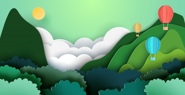 Hete lucht ballonnen op bergen en bos natuur landschap achtergrond.