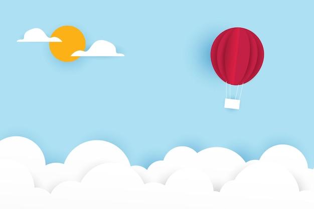 Hete luchtballon papier kunststijl met blauwe hemelachtergrond
