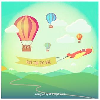 Heteluchtballonnen en een vliegtuig met een banner