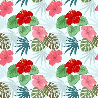 Hibiscusbloemen met tropisch bladpatroon.