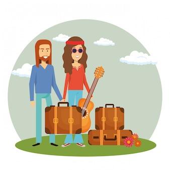 Hippiepaar met bagage en een gitaar