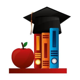 Hoed afstuderen met boeken en appel