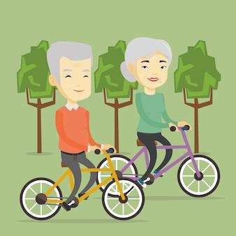 Hoger paar die op fietsen in het park berijden