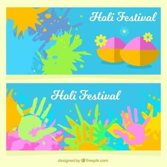 Holi festival banners met kleurrijke handafdrukken en vlekken