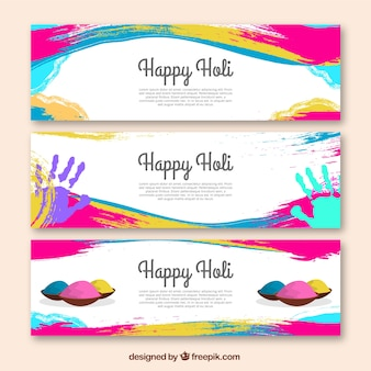 Holi festival banners met kleurrijke vlekken