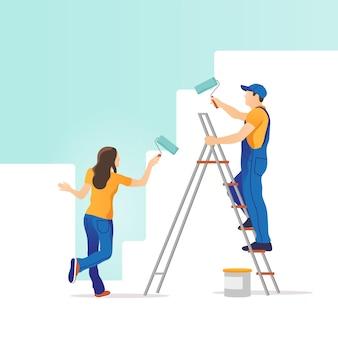 Home reparatie. man en vrouw die de muur in nieuw huis schilderen.