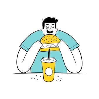 Hongerige man die hamburger eet en frisdrank drinkt