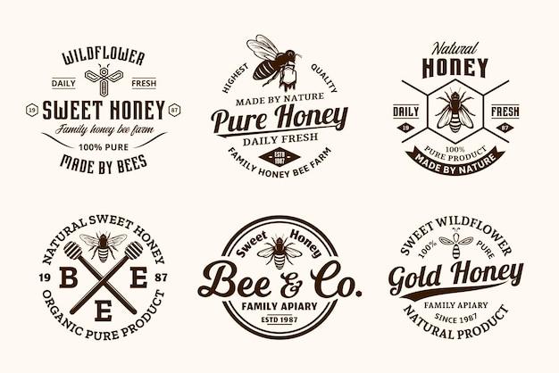Honing vintage logo en pictogrammen voor honingproducten, bijenstal en bijenteelt branding en identiteit