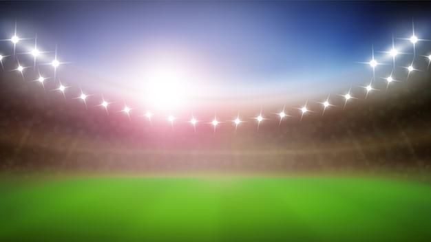 Honkbalstadion met gloeilampen in de nacht
