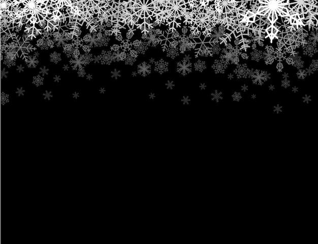 Horizontaal kader met sneeuwvlokken die in duisternis vallen