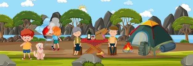 Horizontale buitenscène met familiepicknick in het park