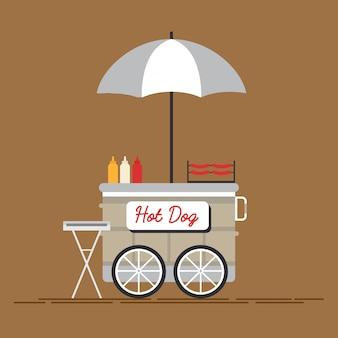 Hotdog straatkar met verkoper.