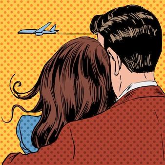 Houdend van paar die een vliegtuig bekijken dat in de hemel van start gaat