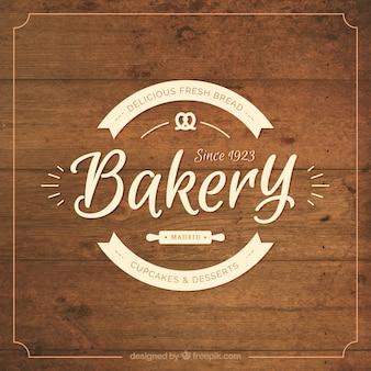 Houten achtergrond met bakkerij badge