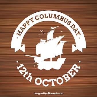 Houten achtergrond met columbus day badge