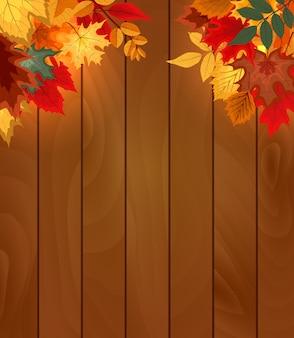 Houten achtergrond met vallende herfstbladeren