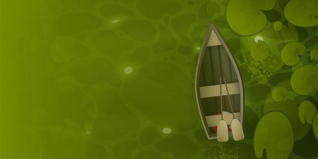 Houten boot drijft door het moeras met waterleliebladeren