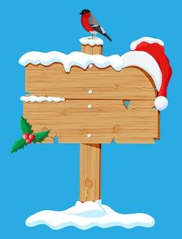 Houten bord geïsoleerd op blauw met goudvink vogel, hulst en kerstman hoed. gelukkig nieuwjaar decoratie. vrolijk kerstfeest. nieuwjaar en kerstviering. vector illustratie vlakke stijl