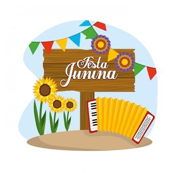 Houten embleem met accordeon en bloemen naar festival