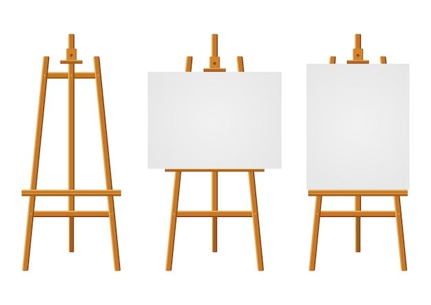 Houten ezels of schilderkunstborden met wit canvas van verschillende formaten. ezels met vellen papier.