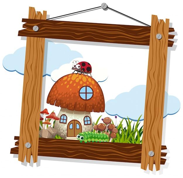 Houten frame met paddestoelhuis en insecten