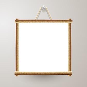 Houten frame wit bord met touw opknoping op een spijker
