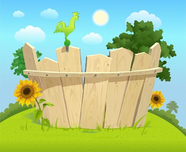 Houten hek op een groene zomer gazon met zonnebloemen