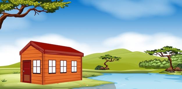 Houten huisje bij de vijver